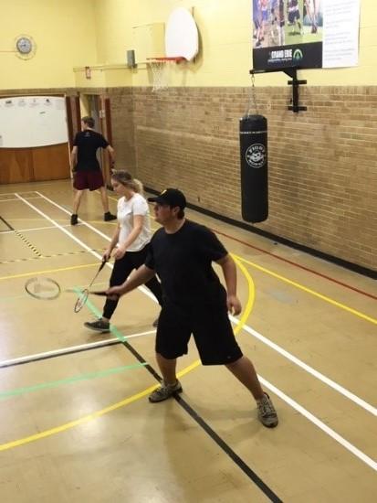 Students play indoor tennis
