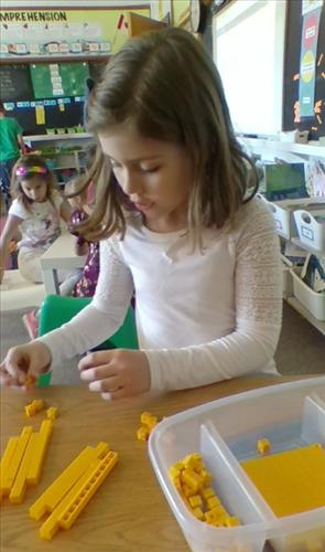 A female student works with math manipulatives