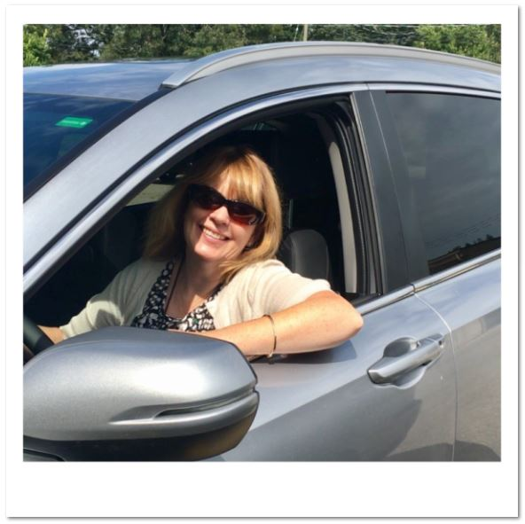 Director Brenda Blancher smiles from the driver's seat
