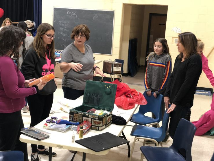 Students and teachers prepare sets for a play production