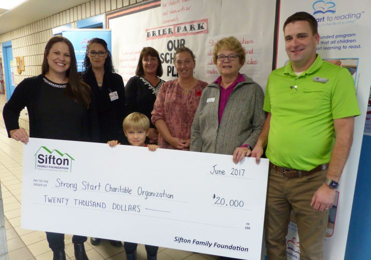 Members of Sifton Family Foundation and Strong Start program pose with large novelty cheque during donation