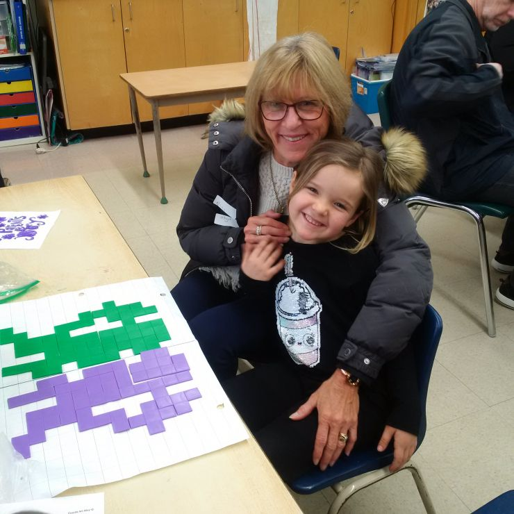 A grandmother and granddaughter take part in Grandparents Day