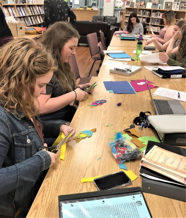 Students in the World Cultures class construct Faceless Dolls for the project