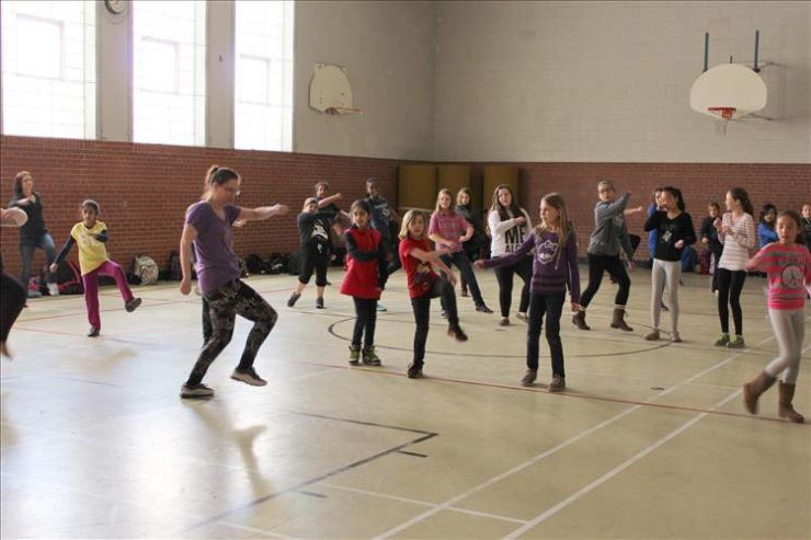 Students participate in a dance class during an Art Soup workshop